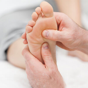 A foot being massaged