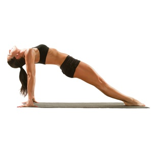 A lady doing the reverse plank pose during Pilates